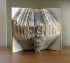 Folded book page sculptures / Luciana Frigerio