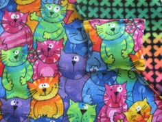 COLORFUL CATS Catnip Blanket and Catnip Toy  COLORFUL CATS Catnip Blanket and Catnip Toy Beautiful , Bright and Whimsical Flannel Print ..   The Reverse Side is a Coordinating Printed Fleece. Each Blanket come with a Generous Hand Full of 100 % Organic Catnip from Montana.  18″ x 24″  Toy is 4″ x 4″ and  Filled with 100 % Organic Cat Nip