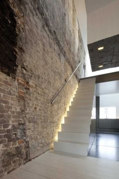 brick wall with up lights going up the stairs. (veneer brick) and metal and cable railing. the brick will be more natural color Interior Stairs, Interior Architecture, Exterior Design, Interior And Exterior, Escalier Design, Stair Lighting, Indirect Lighting, Old Apartments, Design Moderne