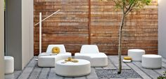 The Moon Island collection was designed by Gerd Couckhuyt for MANUTTI and surprises with its playful concept: four 'islands' that can be combined and rearranged around a central coffee table or footrest. The design is simple and pure. Lounging - Belgian outdoor furniture - leather - terrace