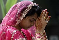 A married Hindu woman performs rituals on Karwa Chauth celebrated where married women fast one whole day and offer prayers to the moon.    by https://www.facebook.com/pages/Shanti-ayurvedic-beach-Resort/111984498843384