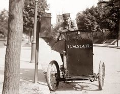 This is a pretty cool picture from 1912. It shows a Mail Man on a little motorized card. The cart looks to perhaps be a 3 wheel type device. At first I thought he was delivering mail, but upon closer inspection it looks like the cart is designed to receive mail from mail boxes. It looks like their is a chute, and the mail from the mailbox dumps down into the cart.