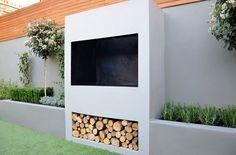 outdoor fireplace BBQ fire raised beds modern garden design london