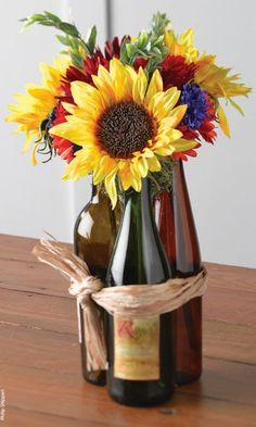 Wine bottles used as 50th birthday party decorations.  See more decorations and 50th birthday party ideas at http://www.one-stop-party-ideas.com
