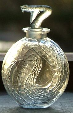 SERPENT A superb perfume bottle depicting a coiled serpent. Condition excellent. Date c1920. Signed in script to base.