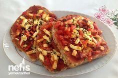 Ekmek Pizzası Tarifi nasıl yapılır? 120 kişinin defterindeki Ekmek Pizzası Tarifi'nin resimli anlatımı ve deneyenlerin fotoğrafları burada. Yazar: Pınar Topuk