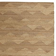 An innovative twist on traditional jute rugs, this version brings just the right touch of pattern to the room. The oversized chevron design is created by the natural contrast between hemp and jute fibers. Easy-going and incredibly durable with a nice nubby texture and self-bound edging for a clean finish. Reversible.