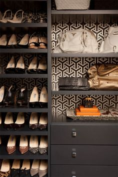 That wallpaper on the back of a bookshelf made into a shoe shelf is pure genius!