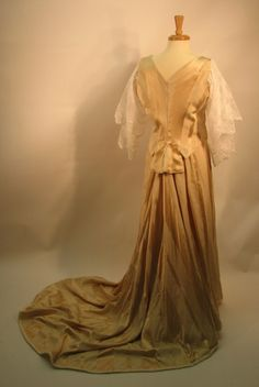 Back view of the 1898 dinner suit showing the bodice peplum detail and the elaborate train.