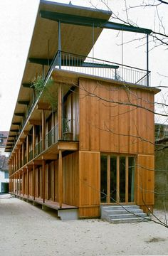 Herzog & de Meuron - Apartment building along a party wall, Basel Photos (C) Margherita Spiluttini. Container Architecture, Wood Architecture, Residential Architecture, Contemporary Architecture, Architecture Details, Residence Senior, Wood Facade, Small Buildings, Wooden House