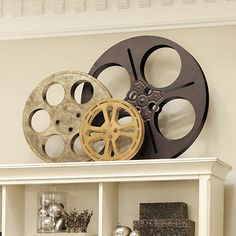 Love it! Old film reels for art and picture frames. I would hang it on the wall in bright painted colors. Or maybe half dipped with color and dripping.