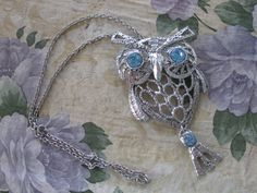 Another for the owl lovers!  This is a large articulated owl silver tone owl with moving parts and sparkling light blue eyes!  Only $24.99 with free shipping.