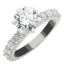 LOVEEE THIS - AND THE BAND - EVEN WITH 2 SMALL ON SIDE. THIS IS IT. Classic Prong Set Diamond Engagement Ring (ring « Holiday Adds