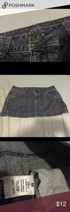Guess Denim Mini Skirt Denim mini skirt from Guess with rhinestones on one of the back pockets. Lightly used but still in good condition. Looks great with a pair of boots! Guess Skirts Mini