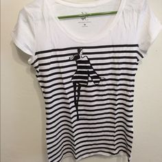 Whimsical striped top with sequins. Striped top with a cute graphic on the front. The sequins are in the lady's dress. Longer in length. From New York & Co. Size small. Never worn. New York & Company Tops