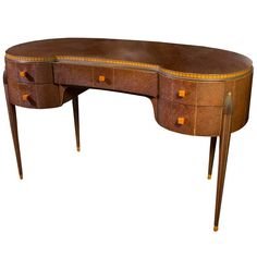 1stdibs.com | Art Deco Amboyna Wood Kidney Form Desk in the Manner of Ruhlman circa 1925