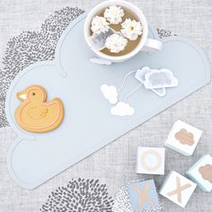 Sometimes you just need a giant ducky cookie & a cuppa! Cloud placemats aren't just for kids, their for big kids too! bluebrontide.com #organicbaby #babyaccessories #thatsdarling