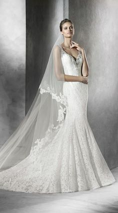 e1bf1d0c Pronovias Prama is a luxurious mermaid dress! It boasts a V neckline with  gemstone and