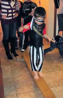 """""""Walk the Plank!"""" Pirate Birthday Party Game by www.itsybelle.com - if it's warm & nice out maybe over the baby pool????"""