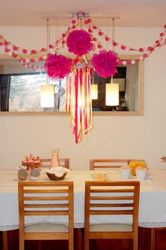 Circle paper garlands, tissue paper pompoms and ribbon mobile. Made by @Fran Bustamante #party #decor #diy #kids