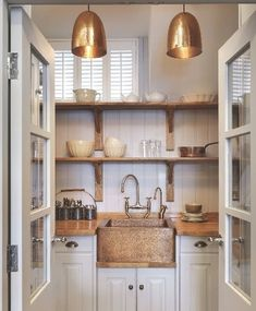 Brass or copper can add a warmth to a kitchen or butlers pantry.