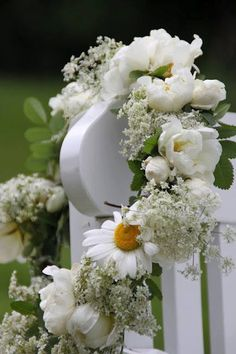 It's a beautiful world!   White on white flowers and fence