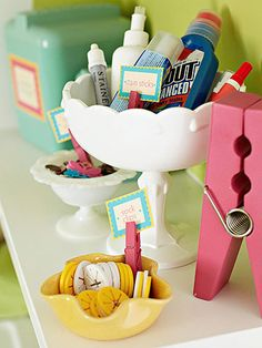 Organize small laundry room supplies and miscellaneous items such as sock clips and buttons in attractive dishes of all different sizes. Use scrapbooking supplies to make labels, and display them with clothespins.