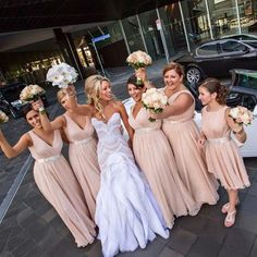 Love the bridesmaid dresses and brides dress.