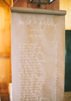 Table assignments on brown paper.  Elegant Kansas wedding | Real Weddings and Parties | 100 Layer Cake