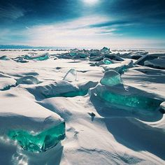 Turquoise ice exposed at Lake Baikal in Russia.