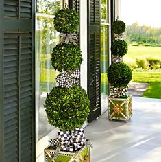 Topiary Flank a doorway with two Courtly Check® Triple Tier Topiaries to really make a statement. Handcrafted topiary, embellished with Courtly Check® ribbons in a hand-painted polyresin pot. Porch Topiary, Topiary Decor, Outdoor Topiary, Topiary Trees, Topiary Garden, Mackenzie Childs Inspired, Mckenzie And Childs, Front Entrances, Front Door Decor