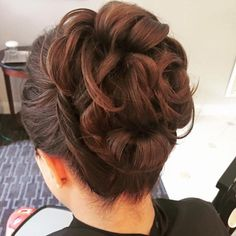 high bun updo by Do's & Dye by Julie in West Hartford, CT