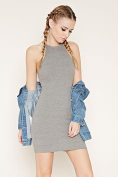 This sleeveless mini dress is crafted from ribbed knit and features a high round neckline and a bodycon fit.