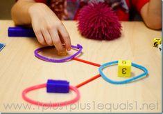 Number bonds using various materials: dice, cubes, bears, counters, etc.