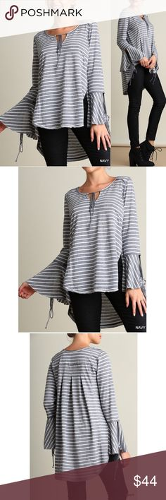 """❗️LAST❗️Stripe wide neck bell sleeves top Navy striped bell sleeve high low top featuring tassel tie front, wide neck and bell sleeves Material: 60% cotton, 40% polyester Lightweight Non-sheer Woven Unlined Relaxed fit Model is 5'7"""" and wearing a small   Measurements:  Small: 2/4 Bust: 35-36""""  Medium: 6/8  Bust: 37-38""""  Large: 10/12 Bust: 39-40"""" (1 LH-c) Pink Peplum Boutique Tops Tunics"""