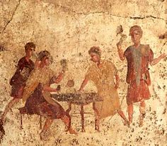 This wall-painting illustrates two men sitting at a wooden table, playing a game of dice. They are watched by two other men. It is one of the 13 wall-paintings depicting popular scenes (mostly social activities that might take place in a bar) that adorned the walls of a bar on one of the main streets of Pompeii.