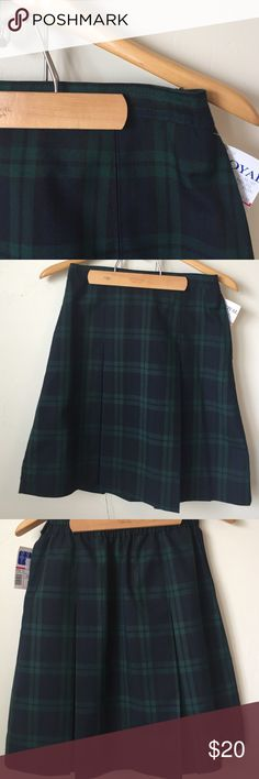 "NWT Plaid Uniform Skirt with Kick Pleat NWT pleated plaid uniform skirt with kick pleat. Side zip and button closure. Elastic back waistband. 20.5"" length. Bottoms Skirts"