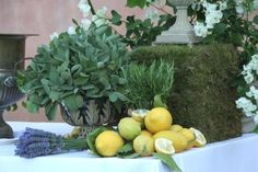 wonderful Tuscan-inspired decoration: sage, rosemary, lavender and lemons...love this look for an accent wedding table