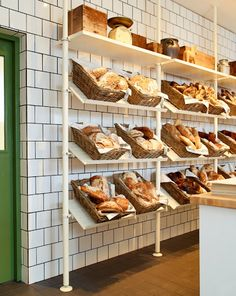 Bread displayed in BYHOLMA rattan baskets on STOLMEN shoe racks