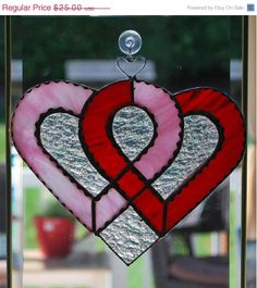 This double heart knot sun-catcher is approx. 8 X and is finished in Tiffany style copper foil technique. Hanging Stained Glass, Stained Glass Ornaments, Stained Glass Suncatchers, Stained Glass Designs, Stained Glass Patterns, Mirror Mosaic, Mosaic Glass, Glass Boat, Cut Glass