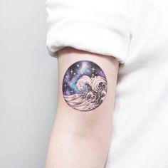 Cosmic wave tattoo by Tattooist Ida
