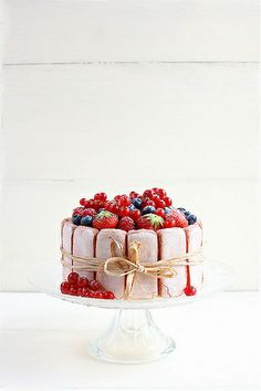 Pink  Rose Charlotte cake with strawberries raspberries red currants and blueberries by Ada Charlotte Au Fruit, Charlotte Cake, Charlotte Russe, Desserts Sucrés, French Desserts, Sweet Desserts, Sweet Recipes, Delicious Desserts, Cake Recipes