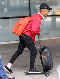 Mover and shaker: On Saturday Jaden Smith, 18, landed back at JFK, and attracted quite a bit of attention due to some peculiar rolling…