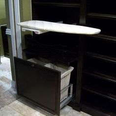Built-in ironing board and laundry hamper bins - great for dressing area or walk-in master bedroom closet
