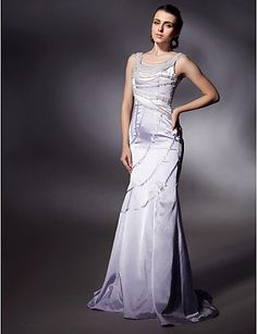 Image from http://www.promdress4girl.com/images/Beautiful%20White%20Pearl%20Detail%20Long%20Evening%20Dresses%20by%20Natalie%20Imbruglia%20at%20Cannes%20Film%20Festival%20CBD8280249.jpg.