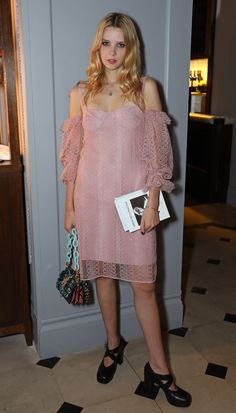 British poet Greta Bellamacina wearing an embroidered tulle off-shoulder dress in pale rose from the Burberry September collection. Greta hosted the poetry event at Thomas's, Burberry 121 Regent Street.