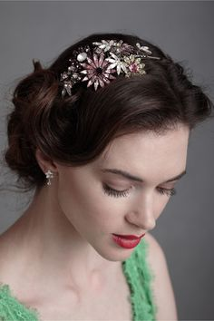 """Jeweled Firecrackers Headband  $315.00     WRITE A REVIEW  STYLE: 24377624    Sparkling pinwheels of amethyst, blush, white, and pale gold burst in a wave of colorful light. From Louis Mariette. Comes with a pair of rubber caps for the ends of the headband to provide comfort. 5""""L, 2.5""""W embellishment at widest points. Palladium plated brass, Swarovski crystals. Handmade in UK."""