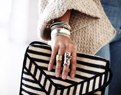 Black and white stripes clutch. So if you aren't ready to go all the way with stripes, just add some in your accessories:) This little clutch with the bangles and rings has class and chic written all over it:)
