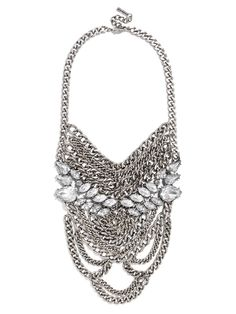 This elongated chain bib is like a full coat of armor with regal, winged gem work. #baublebar #swatstyle #statement #necklace