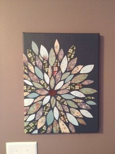 DIY canvas art with scrap book paper cut into shapes. I like this for maybe over the bookshelves.